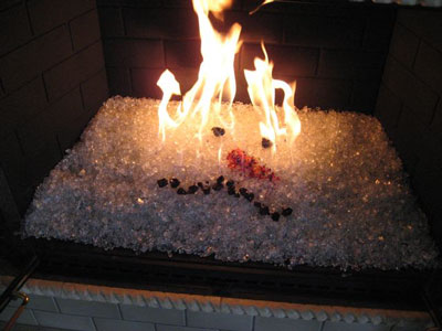 The fireplace below is in Los Angeles California. It was remodeled in a  silver and clear ceramic tile which made it look very modern and  contemporary. - Fire Pit Glass On Fire, Fireplace Glass Fireglass Glass And Ice On